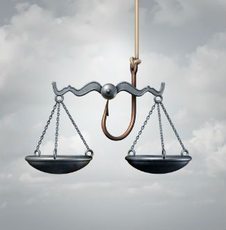 Scales Of Justice And Entrapment Houston Texas Criminal Defense Attorney.